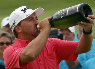 Graeme McDowell drinks champagne after winning the French Open Golf tournament at Paris National course.