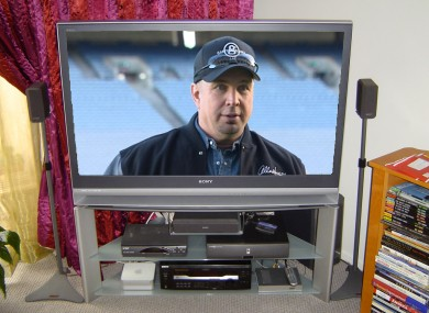 Yes, we Photoshopped Garth Brooks' face amateurishly onto a TV screen. What about it?