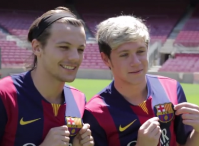 Louis and Niall show the Barca badge some love.