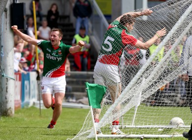 Lee Keegan hits the back of the net after scoring a goal as Cillian O'Connor celebrates setting him up.