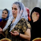 Displaced Christians who fled the violence in Mosul, pray at Mar Aframa church in the town of Qaraqoush on the outskirts of Mosul on  Saturday, July 19, 2014.   Iraq was home to an estimated 1 million Christians before the 2003 US-led invasion that ousted Saddam Hussein. Since then, militants have frequently targeted Christians across the country, bombing their churches and killing clergymen. Under such pressures, many Christians have left the country. Church officials now put the community at around 450,000. (AP Photo)<span class=