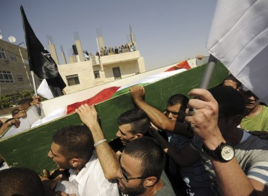 Palestinians carry the body of 16-year-old Mohammed Abu Khdeir in Jerusalem