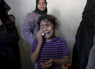 Asma weeps at the funeral of her brother, Gomha Abu Shalouf