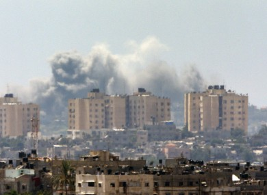 Smoke rises following an Israeli strike on Gaza, seen from the Israel-Gaza border.