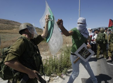 A Palestinian confronts an Israeli soldier, left, during a demonstration near the West Bank town of Nablus.