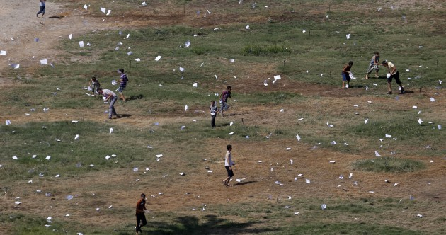 In pics: Israeli plane drops leaflets warning Gaza civilians