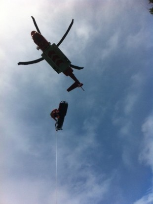 Swimmer being airlifted to safety.