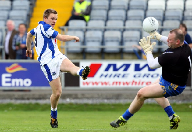 Ross Munnelly has his shot saved by Paul Fitzgerald