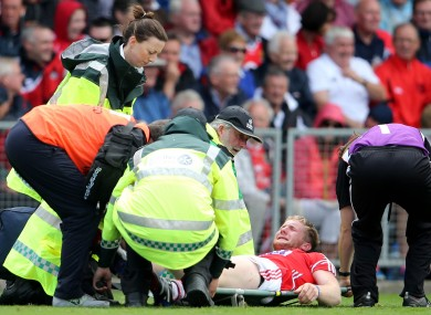 Ruairi Deane is attended to by Cork medics during today's game.