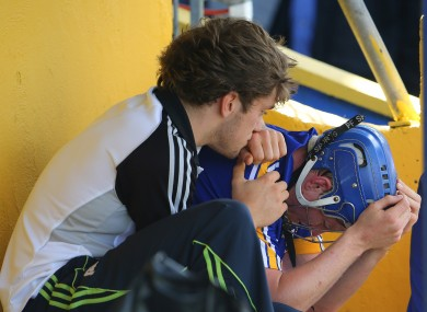 Clare's Shane O'Donnell consoles Podge Collins after he was sent off.