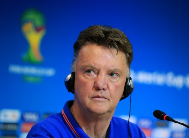 Van Gaal listens to the media's questions yesterday.