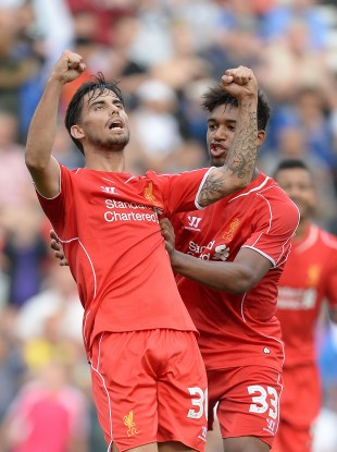 Liverpool's Suso (left) celebrates scoring his teams first goal against Preston.