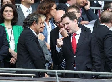 Clegg [R] with Michele Platini in 2011.