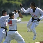 Taiwan Marine Corps display martial arts techniques during a tour at the naval base in Zuoying, southern Taiwan. Photographed by: Wally Santana <span class=