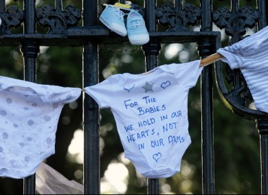 Justice for the Tuam Babies march. Items of baby clothing were tied to the railings at the back of Leinster House.