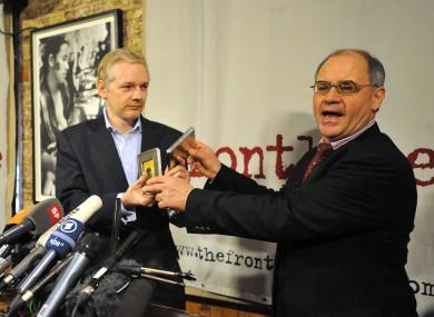 File photo dated 17 January 2011: Rudolf Elmer hands two CDs to WikiLeaks founder Julian Assange.