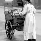 A woman delivering milk supplies in the west end of London.<span class=