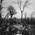 French soldiers collecting title deeds and official documents from among the ruins of the Notary's House at Curlu on the Somme.<span class=