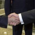 Russian President Vladimir Putin, left, shakes hands with Ukrainian President Petro Poroshenko, right, prior their talks in Minsk, Belarus.<span class=