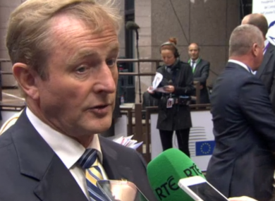 Enda Kenny talks to reporters in Brussels.