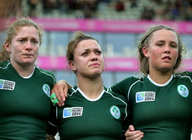 Grace Davitt, Lynne Cantwell and Ashleigh Baxter show their disappointment following the loss to England.