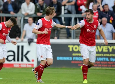 St Patrick's Athletic's James Chambers congratulates goalscorer Chris Forrester.