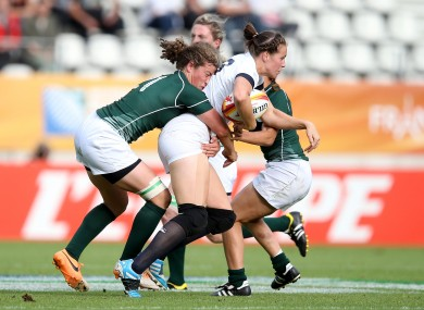 Ireland's Jenny Murphy tackles Emily Scarratt, one of 20 English players about to turn pro.