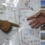 Philippine Military Spokesman Maj. Gen. Domingo Tutaan, left, points to a map to show the area of operations of Filipino peacekeepers at Golan heights beside Col. Roberto Ancan, Commanding Officer of the Armed Forces of the Philippines PeaceKeeping Operations Centre.<span class=
