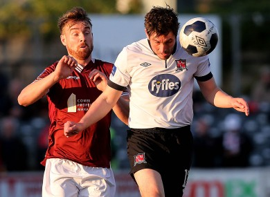 Ruaidhri Higgins of Dundalk and Vinny Faherty of Galway fight for possession.
