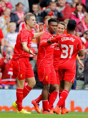 Daniel Sturridge is congratulated after his goal.