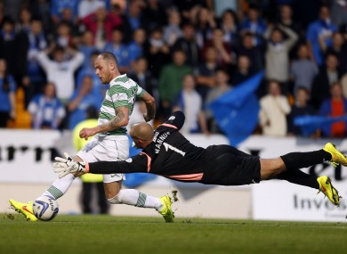 Celtic's Anthony Stokes scores with St Johnstone's Alan Mannus (right) during the Scottish Premier League match at McDiarmid Park, Perth.
