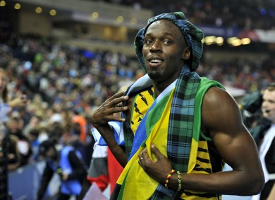 Jamaica's Usain Bolt wears tartan as he celebrates after winning the Men's 4x100m Relay at Hampden Park.