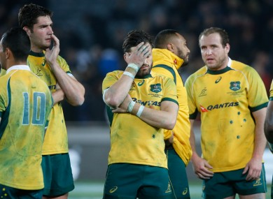 The Australian team dejected after the game.