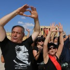 Some 6,000 people raise their arms and form a heart-shape with their hands as they gather to form a large portrait of Mustafa Kemal Ataturk, the founder of modern Turkey at his mausoleum in Ankara.<span class=
