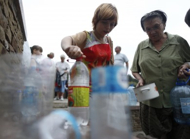 Locals queue to collect water in Donetsk, Ukraine yesterday.