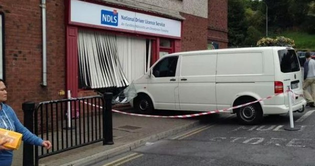 Van rolls down hill… and into a driving licence office