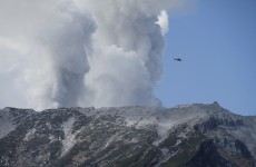 More than 30 feared dead in Japan as volcano continues to erupt