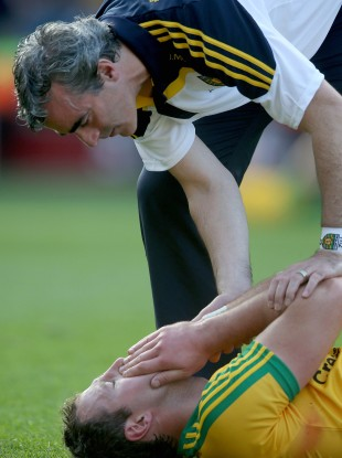 Jim McGuinness consoles Donegal's Michael Murphy.
