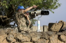 Syrian troops and Islamist rebels exchange fire near peace line in Golan Heights