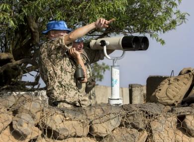 UN soldiers observe Syria's Quneitra province.