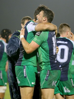 Quinn Roux and Robbie Henshaw embrace after beating Leinster.