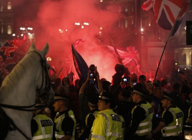 Police stand in front of Unionists gathered in George Square, Glasgow last night.