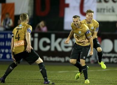 Simon Madden grabs a hold of goalscorer Sheppard.