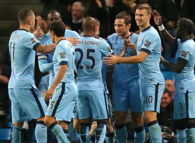The Man City players congratulate Lampard.