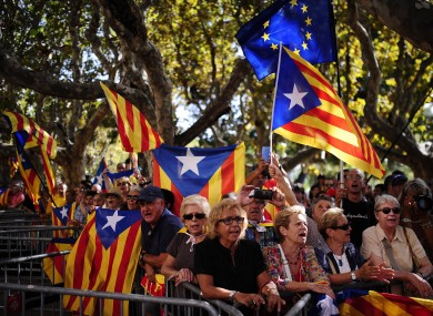 "People wave 'estelada'"" flags, that symbolize Catalonia's independence, during a demonstration calling for the independence of Catalonia."