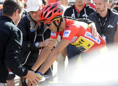 Alberto Contador of Spain is helped after winning the 20th stage of the Vuelta.