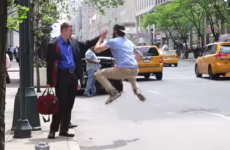 Man runs around New York high fiving people trying to hail taxis
