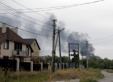 Smoke rises over a residential area in the north of the rebel-held city of Donetsk earlier today.