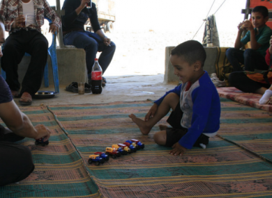 Al Rashiyda bedouin camp EA human rights observer and child.