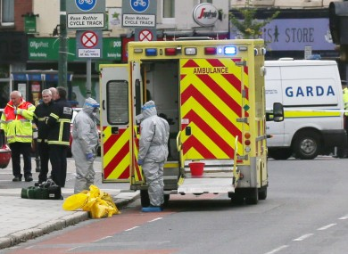Workers in protective gear near the Mater Hospital yesterday.